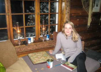 Playing scrabble inside of Skoki  Lodge in Banff National Park, Canada